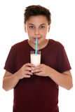 Healthy eating young teenager boy drinking milk Royalty Free Stock Images