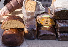 Healthy ecologic natural bread loaf sell market. Healthy ecologic natural bread loaf sell in outdoor street market fair. diet nutrition food Stock Photography