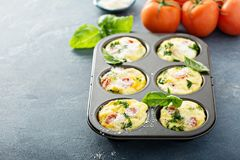 Healthy egg muffins, mini frittatas with tomatoes stock photography