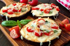 Healthy eggplant mini pizzas close up on a paddleboard Stock Photos