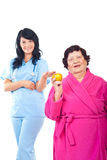 Healthy elderly holding apple Royalty Free Stock Photo