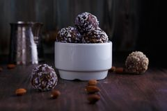 Healthy energy balls with nuts, dates, honey and sesame royalty free stock image