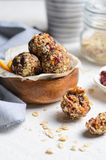Healthy Energy Balls, Raw Vegan Balls with Oatmeal, Cranberry, Dates and Nuts royalty free stock photos