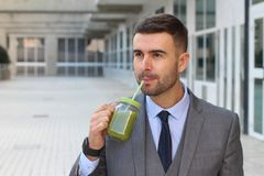 Healthy entrepreneur enjoying a healthy drink Stock Photos