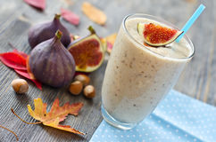 Healthy exotic smoothie variation with figs and nuts Royalty Free Stock Photo