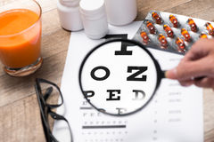 Healthy eyes. Eye chart and medicine Stock Photo