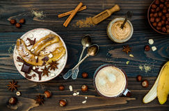 Healthy fall and winter breakfast bowl. Chai tea infused overnight oats porridge topped with caramelized bananas, raw dark. Preparing healthy fall and winter royalty free stock photo