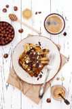 Healthy fall and winter breakfast. Vegan vanilla french toast with caramelized bananas, raw dark chocolate and hazelnut butter Royalty Free Stock Photos
