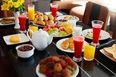 Healthy family breakfast. Fruit, bread, juice. Royalty Free Stock Photography