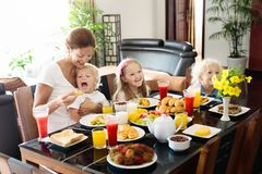 Healthy family breakfast for mother and kids. Stock Images