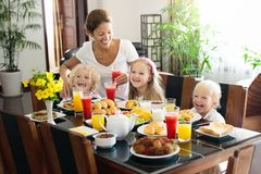 Healthy family breakfast for mother and kids. Royalty Free Stock Photo