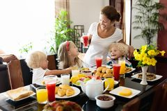 Healthy family breakfast for mother and kids. Stock Photography