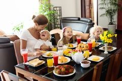 Healthy family breakfast for mother and kids. Stock Image