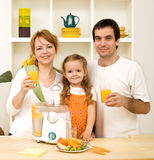Healthy family drinking juice Royalty Free Stock Images