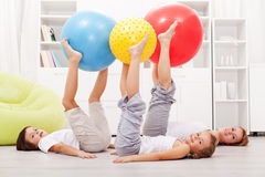 Healthy family exercising at home Stock Images