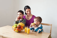 Healthy family. The mother and her two children eating apples Royalty Free Stock Photo