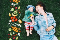 Healthy family nutrition. Mother and baby with fruits and vegeta Stock Photo