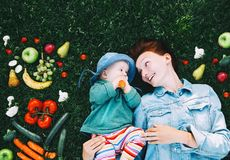 Healthy family nutrition. Mother and baby with fruits and vegeta Royalty Free Stock Photos
