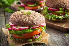 Healthy fast food. Vegan rye burger with fresh vegetables
