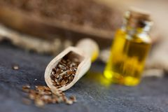 Free Healthy Fat - Linseed On Woden Spoon, Linseed And Linseed Oil In Bootle In The Background Royalty Free Stock Photography - 135913497