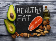 Healthy fat salmon, avocado, oil, nuts Royalty Free Stock Images