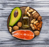Healthy fat salmon, avocado, oil, nuts. Healthy fat salmon, avocado, oil and nuts. Selective focus Royalty Free Stock Image