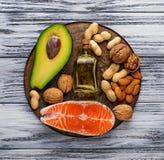 Healthy fat salmon, avocado, oil, nuts Royalty Free Stock Image