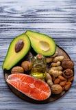Healthy fat salmon, avocado, oil, nuts Stock Photos