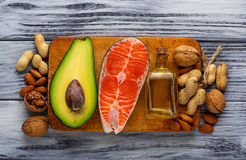 Healthy fat salmon, avocado, oil, nuts. Healthy fat salmon, avocado, oil and nuts. Selective focus Royalty Free Stock Photography