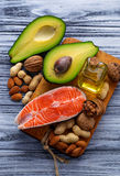 Healthy fat salmon, avocado, oil, nuts Stock Photos
