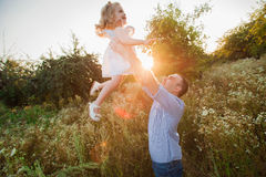 Healthy Father and Daughter Playing Together at Sunset. Royalty Free Stock Photography