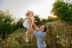 Healthy Father and Daughter Playing Together at Sunset. Royalty Free Stock Photo
