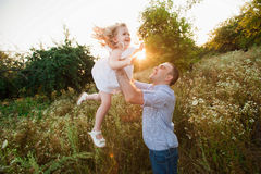 Healthy Father and Daughter Playing Together at Sunset. Stock Images