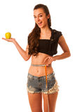 Healthy female body with apple and measuring tape. Healthy fitne Royalty Free Stock Photo