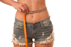 Healthy female body with apple and measuring tape. Healthy fitne Stock Photos
