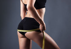 Healthy female body with measuring tape Stock Images