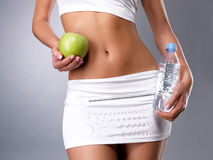 Healthy Female Body With Apple And Water Royalty Free Stock Image