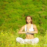 Healthy female doing yoga Royalty Free Stock Photos