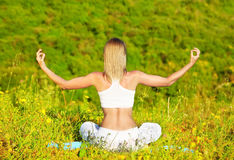 Healthy female doing yoga Stock Images