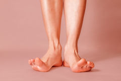 Healthy female feet. With splayed fingers on pink background Royalty Free Stock Photo