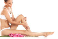 Healthy female legs on white background. royalty free stock photography