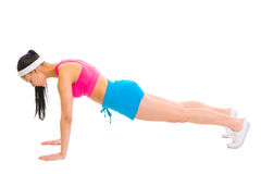 Healthy female making push up exercises Stock Images