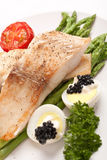Healthy fish with asparagus Royalty Free Stock Photography