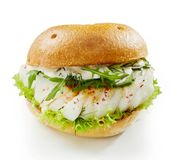 Healthy fish burger with rocket and mayonnaise stock photography