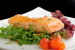 Healthy fish cuisine : baked pink salmon steaks Royalty Free Stock Image