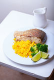 Healthy Fish Dinner. With saffron rice and vegetables Royalty Free Stock Photos