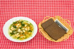Healthy Fish soup salmon and whole grain bread in basket on red stock photos