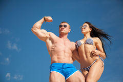 Healthy fit couple on sky background. Stock Photography