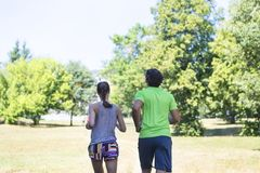 Healthy, fit and  sportive couple running in park Stock Photography
