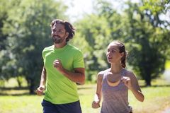 Healthy, fit and  sportive couple running in park Stock Image